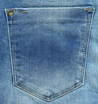 Jeans pocket. Shabby blue denim. Light blue fabric texture