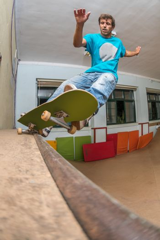 Skateboarder performing a pivot grind