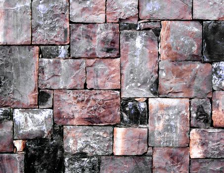 Background of Grey, Black and Red Cobblestones with Sharp Spears closeup Outdoors