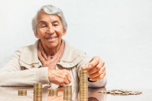 Senior woman saving money or budgeting