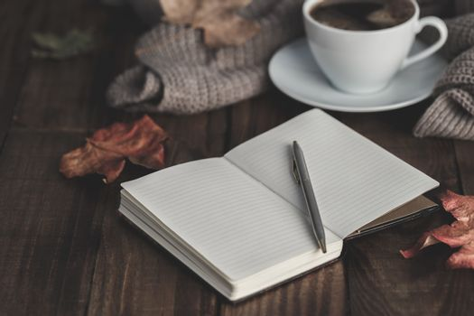 Notebook, pen and coffee