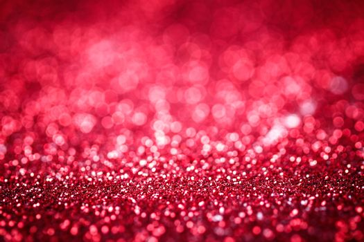 Red glitter texture christmas or valentine's day background. Macro shot