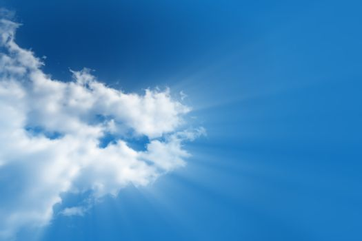 A bright white cloud from which the divine light rays flows in a clear, bright blue sky