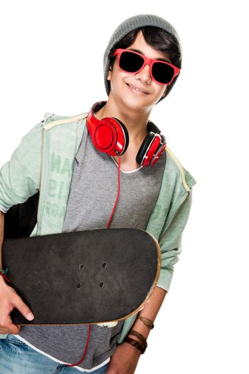 Portrait of stylish teen boy with skateboard in hands isolated on white background, good sportive hobby, active modern lifestyle