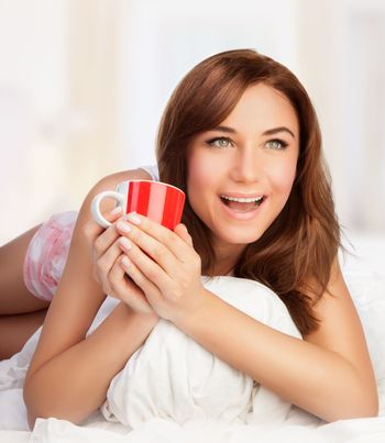 Happy woman with cup of tea