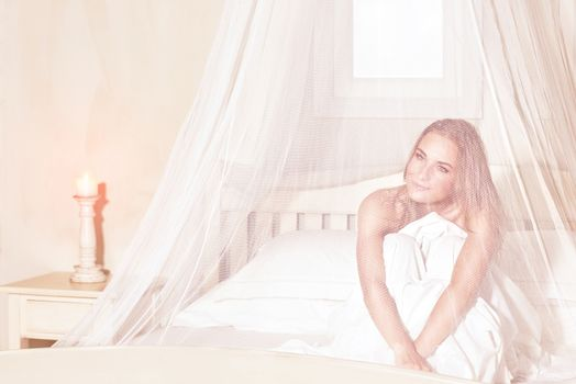 Romantic woman in the bed