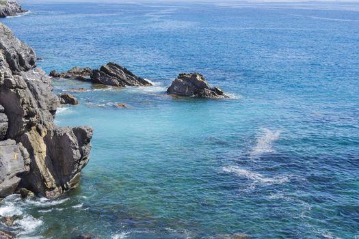 Rocks and blue sea in Genoa Nervi