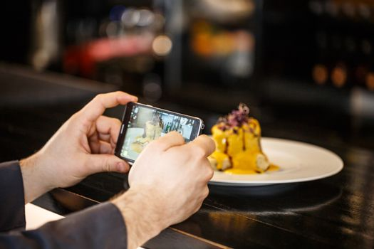 Chef photographing his creation
