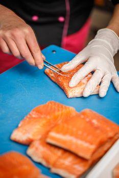 Chef removing fish bone
