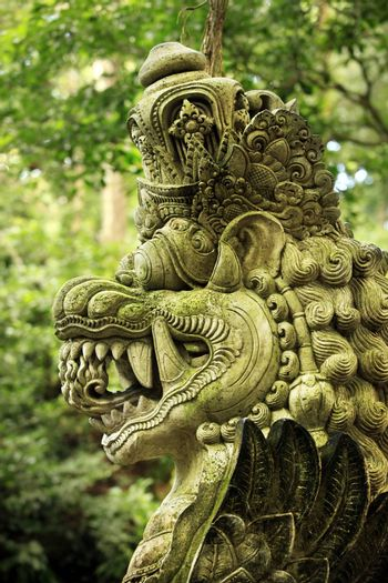 Balinese stone statue before a temple