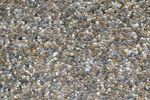 Background photo of colored gravel in a concrete precast slab that serves as wall covering