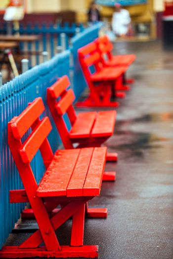 Colorful wooden benches at the Lunapark in Sydney Australia