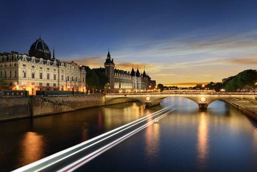 Boat tour on Seine river in Paris with sunset. Paris, France