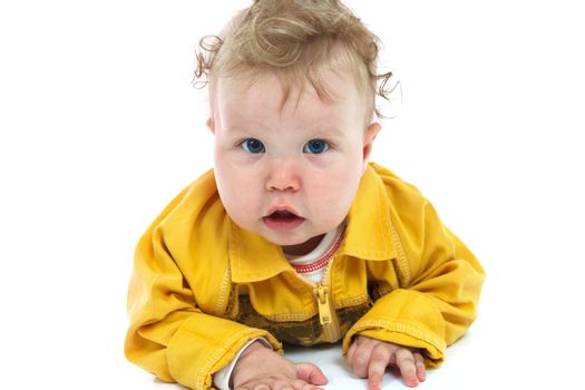Baby in a yellow shirt isolated on white background