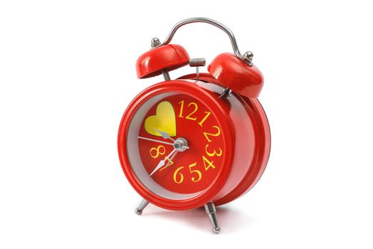 red alarm clock closeup isolated on a white background