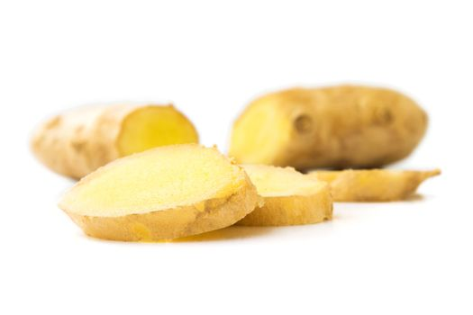 Fresh ginger on white background, raw material for cooking, sele