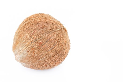 Closeup brown coconut shell on a white background, raw material