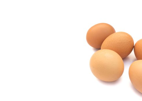 Closeup Eggs on white background, raw material for make cooking