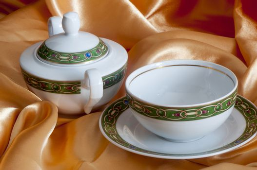 a cup of tea and a sugar bowl