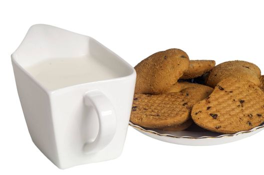 milk and biscuits with chocolate drops on a white background
