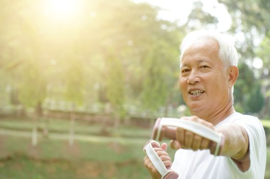 Portrait of healthy white hair Asian old man workout at outdoor park in morning.