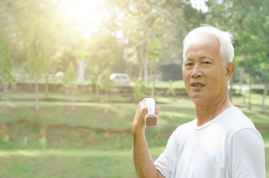Portrait of active healthy grey hair Asian old man workout at outdoor park in morning.
