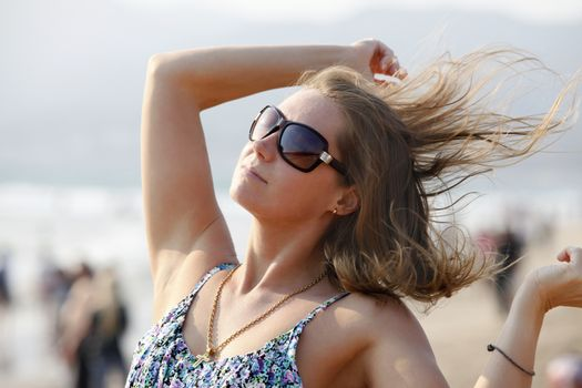 The girl with wet hair in solar glasses