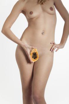 nude woman with a papaya
