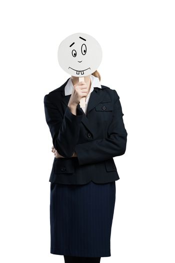 Businesswoman hiding her face behind mask isolated on white