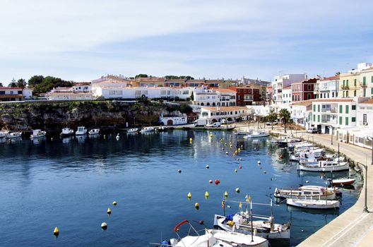 Es Castell Harbor, Traditional Houses and Lagoon on Blue Skies background, Menorca, Balearic Islands