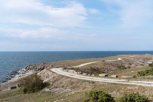 Landscape witha gravel road along the coast