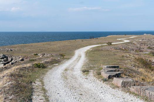 Winding gravel road in a coastal landscape