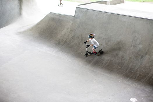 Powerful funny young guys are trained in a skate park Stockholm, Sweden. Leisure, playing, trick