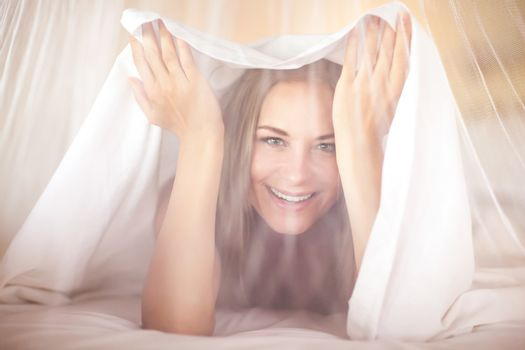 Joyful woman in the bed