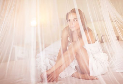 Gentle woman in the bed