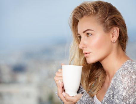 Feminine nice girl with a tea cup