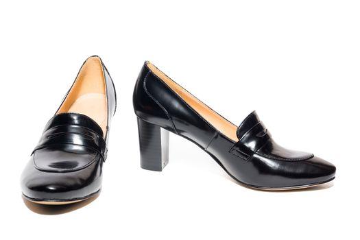 Black female shoes on a white background, isolated, studio