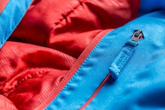 Zipper on blue winter coat