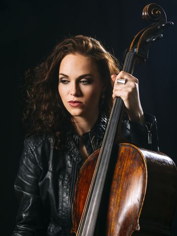 Beautiful cellist holding her cello