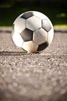 Soccer ball on asphalt