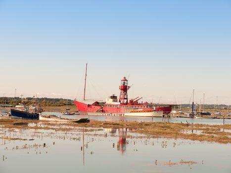 big red life boat moored in estuary tollesbury maldon; essex; england; UK