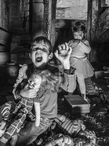 Creepy children and scary dolls in the barn