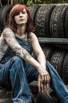 Beautiful redhead mechanic with tattoos