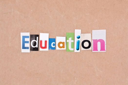 Education, letters sorted on paper background