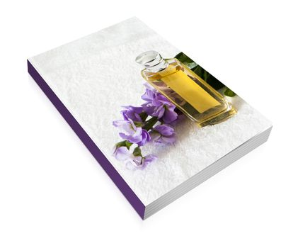 book of a perfume flask over a white towel