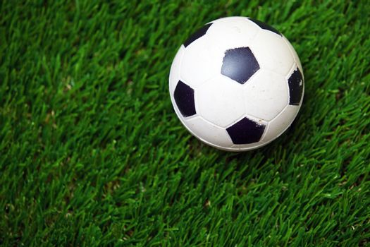 Soccer ball on a grass. Horizontal photo