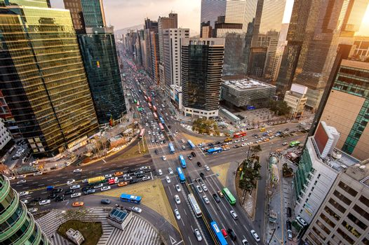 Traffic speeds through an intersection in Gangnam, Seoul in South Korea.