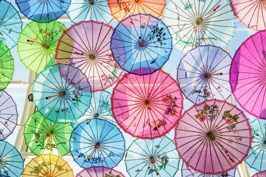 Roof decorated by colorful handmade umbrellas made from paper for protecting sunlight from outside.