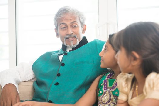 Happy Indian parent and children at home