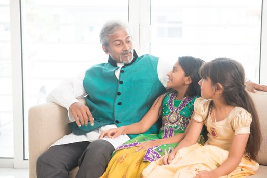 Happy Indian father and daughters bonding